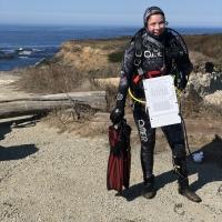 Taylor Zenobia in scuba gear at the ocean